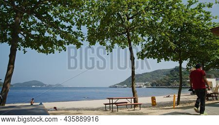 Mui Wo, Hong Kong 03 May 2021: Sea sand beach on sunny day