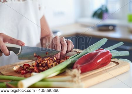 Woman cooking food in kitchen.woman hands cooking food in kitchen. Cooking food lifestyle. Cooking food. woman cooking food at home. Lifestyles. Healthy food.Food cooking woman lifestyle. Food