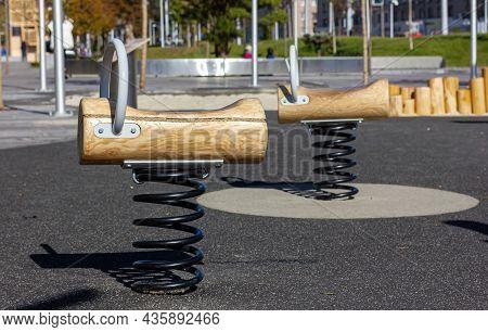 Playground At The Elementary School. Spring Loaded Rocker. Children Playground. Play Equipment.