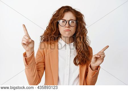 Sad And Gloomy Saleswoman, Young Female Trainee Pointing Fingers Sideways And Frowning Upset, Showin
