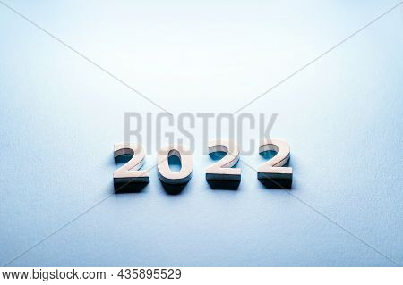 Merry Christmas Theme.happy New Year 2022.minimal Christmas Card On A Blue Background With A Gift. M