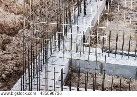 Monolithic Foundation With Metal Reinforcement. Forms Vertical Formwork Structures For The Basement