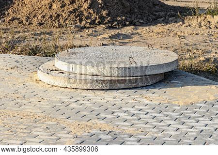Bottoms Of Reinforced Concrete Pit And Sewer Lie Outdoors. Reinforced Concrete Products On Construct