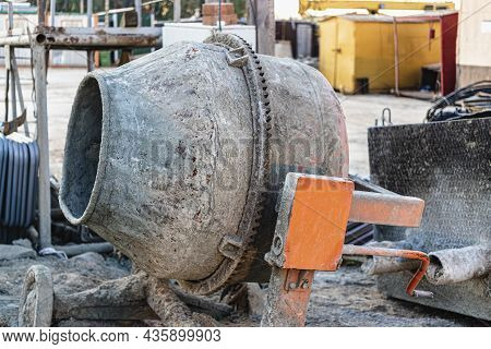 Industrial Concrete Mixer At A Construction Site. Preparation Of Concrete And Mortar