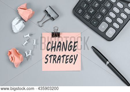 Change Strategy - Concept Of Text On Sticky Note. Closeup Of A Personal Agenda. Top View. Office Con