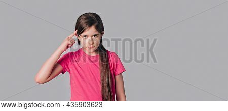 Young Brunette Girl Pointing To Head With One Finger, Great Idea Or Thought, Good Memory, Wear In Ca