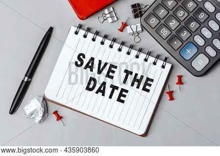 The Words Save The Date Written On A White Notebook. Closeup Of A Personal Agenda. Top View. Office