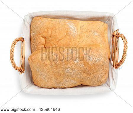 Crispy Ciabatta In Wicker Basket Isolated On White, Top View. Fresh Bread