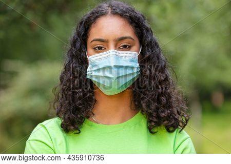 Girl wearing face mask in Coronavirus COVID-19 pandemic