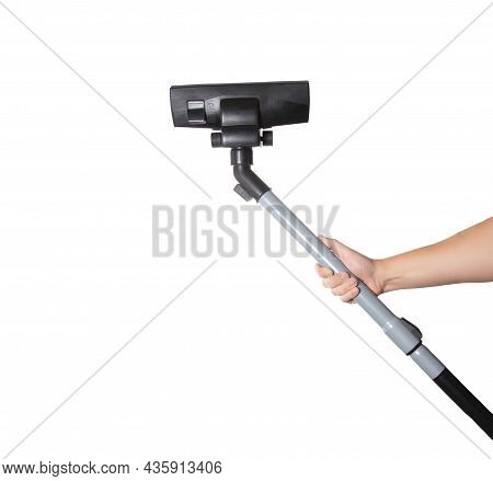 Male Hand Holds A Brush And A Pipe Of A Vacuum Cleaner On A White Background, Isolate. Close-up, Cle