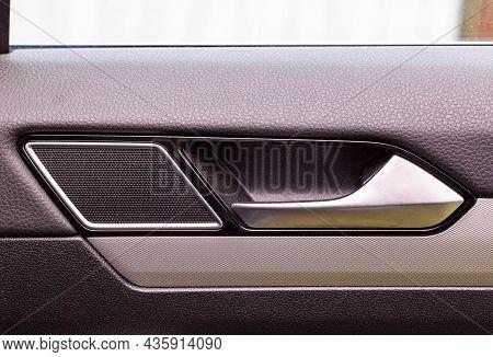 Modern Car Door Trim With Tweeter And Door Handle With Metal Insert, Close-up