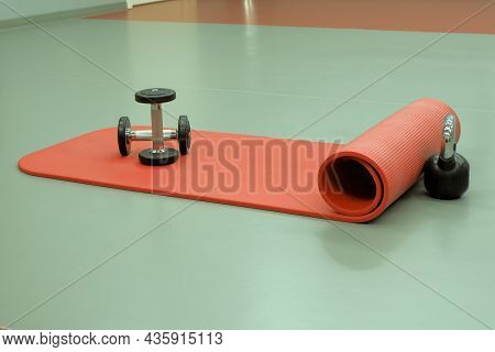 The Props For Fitness Classes Are Lying On The Floor.