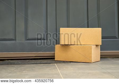 Cardboard Boxes Delivered To The Forn Door And Left Outside For Contactless Pickup, Delivery For Onl