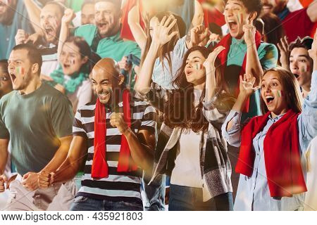Italian Emotive Football, Soccer Fans Cheering Their Team With A Red Scarfs At Stadium. Concept Of S