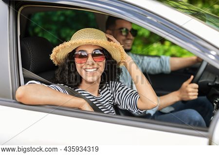 Smiling Middle-eastern Lovers Going To Beach By Car
