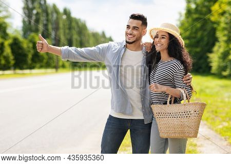 Beautiful Middle-eastern Lovers Hitchhiking While Summer Vacation