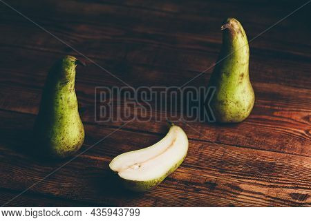 Still Life With Two Whole Conference Pears And One Halved.