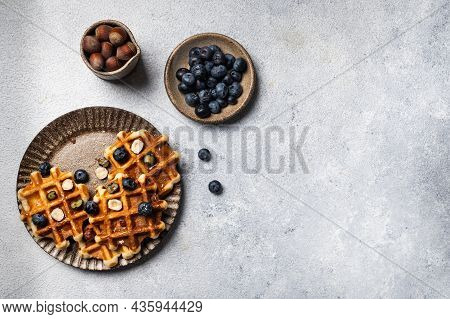 Freshly Made Belgian Waffles With Blueberry And Hazelnut. Waffles With Honey And Berry. Place For Te