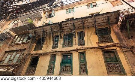 Old Traditional Wooden Windows A In Small Street In Kathmandu, Nepal