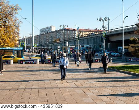 Moscow, Russia - October 5, 2021: People Walk Down The Street Near The Moscow Metro, Vdnkh Station.