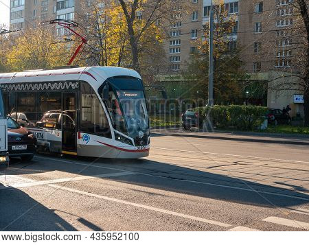 Moscow, Russia - October 5, 2021: City Tram And Cars Go Along The Streets Of Moscow.