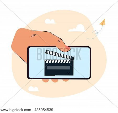 Human Hand Holding Huge Smartphone With Clapper On Screen. Filmmaking Application Flat Vector Illust