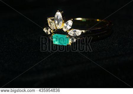 Paraiba And Zircon Gold Rings