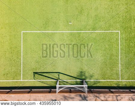 Soccer Ground Detail. Outdoor Sport Ground With Green Surface For Playing Football  Or Soccer  In Ur