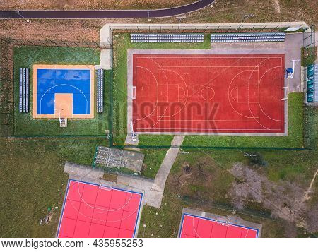 Colorful Basketball, Volleyball And Soccer Grounds. A Red ,orange And Blue Colored Outdoor Sports Gr