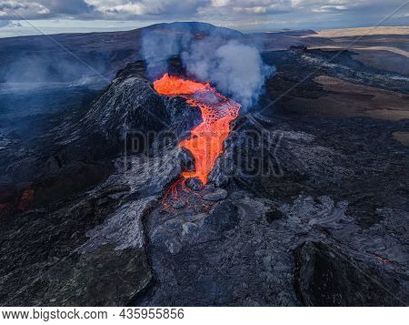 Lava Flow From The Crater Opening Of Fagradalsfjall Volcano. View From Above Into The Volcanic Crate