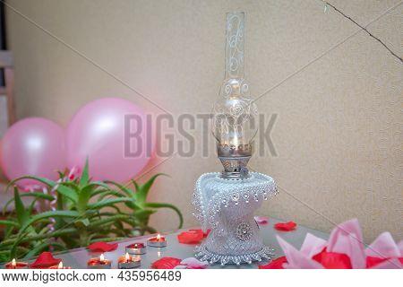 Kerosene Lamp On Rustic Table. Vintage Kerosene Lamp On Table .vintage Kerosene Oil Lantern Lamp Bur