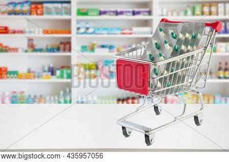Medicine Pills Blister Pack Capsule In Shopping Cart On Pharmacy Store Counter With Blur Drugstore S