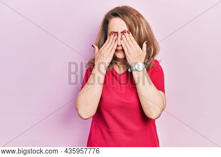 Middle age caucasian woman wearing casual clothes rubbing eyes for fatigue and headache, sleepy and tired expression. vision problem
