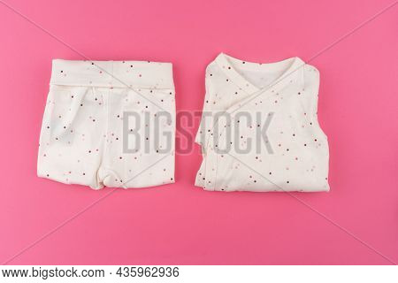 Baby Clothes On Pink Background Top View