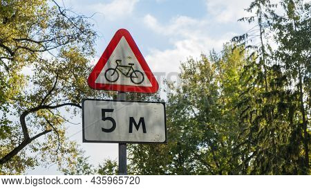Bike Traffic Road Sign. A Red And White Triangular Road Sign Warns Of Cycling That Can Cross The Roa