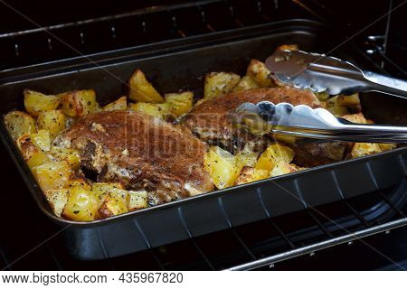 Two Baked Pork Steaks With Potatoes. Meat With Potatoes In The Oven. Homemade Food. Pork Meat Stew W