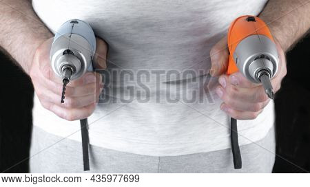 Two Cordless Screwdrivers Prepared For Twisting And Drilling