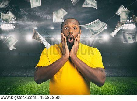 Astonished Man For Winning A Sport Bet. Rain Of Money Inside A Soccer Stadium