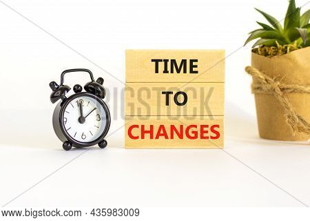 Time To Changes Symbol. Concept Words 'time To Changes' On Wooden Blocks. Black Alarm Clock, House P
