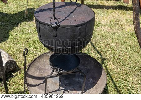 Cooking Equipment Replicas Used By Medieval Vikings Displayed By A Re-enactment Troupe At A Village