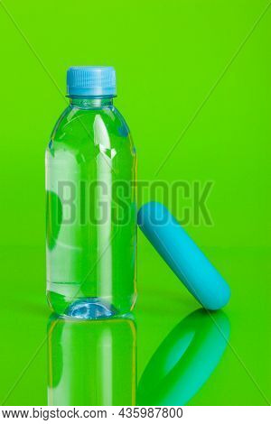 Crystal Clear Water In A Bottle On Green Background