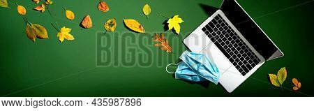 Laptop Computer With Masks In Autumn - Overhead View