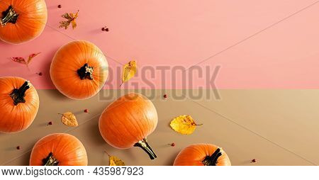 Autumn Pumpkins With Colorful Leaves Overhead View - Flat Lay