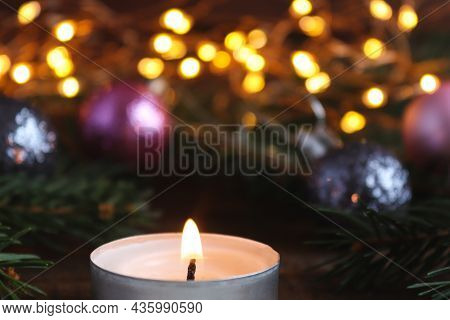 Christmas Greeting Caed With Christmas Decorations, Lights, Christmas Tree Branches, Candle And Boke
