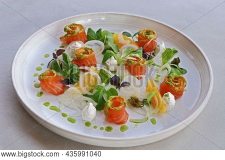 Salmon Gravlax, Salt And Sugar Cured Fresh Salmon In A Serving Plate With Leaves And Garnish