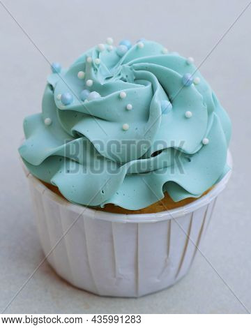 Frosted Decorated Cupcake Isolated With White Background In Close Up