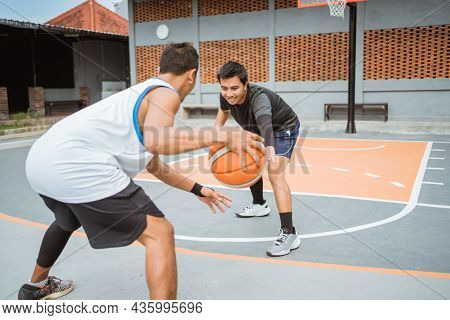 A Defender Prevents An Opposing Player From Dribbling The Ball While Playing