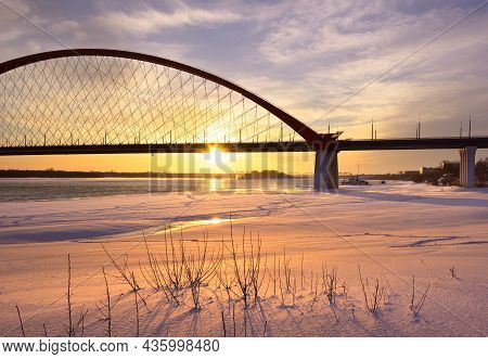 Winter Morning On The Ob. Bright Sunrise Under The Arch Of The Bugrinsky Automobile Bridge On The Fr