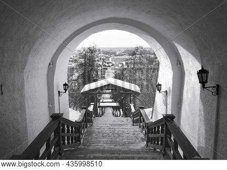 Tobolsk Kremlin In Winter. The Stairs Are Raised Under A Stone Arch. Old Russian Architecture Of The