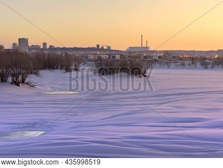 Winter Morning On The Ob. Frozen Snowy River Bank, Residential House, The Pipes In A Thermal Power P